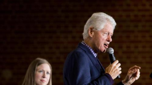 Former President Bill Clinton, accompanied by his daughter Chelsea Clinton, left, speaks at a campaign stop for his wife Democratic presidential candidate Hillary Clinton at Lincoln High School in Des Moines, Iowa, Saturday, Jan. 16, 2016(AP Photo/Andrew Harnik)