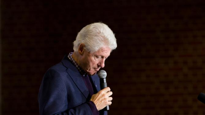 Former President Bill Clinton pauses as he speaks at a campaign stop for his wife Democratic presidential candidate Hillary Clinton at Lincoln High School in Des Moines, Iowa, Saturday, Jan. 16, 2016(AP Photo/Andrew Harnik)