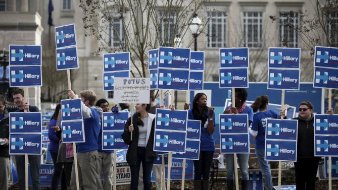 Hillary Clinton supporters stand along Calhoun Street outside the Gaillard Center before the start of the NBC News-YouTube Democratic Debate in Charleston, South Carolina, January 17, 2016. REUTERS/Randall Hill