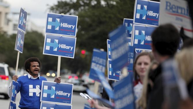 Alex Dobranic, a Hillary Clinton supporter from Charleston, shouts slogans along Calhoun Street before the start of the NBC News-YouTube Democratic Debate in Charleston, South Carolina, January 17, 2016. REUTERS/Randall Hill