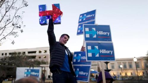 A supporter chants for Democratic presidential candidate Hillary Clinton during a rally outside the Gaillard Center where the Democratic debate is set to be held Sunday, Jan. 17, 2016, in Charleston, S.C. (AP Photo/Stephen B. Morton)