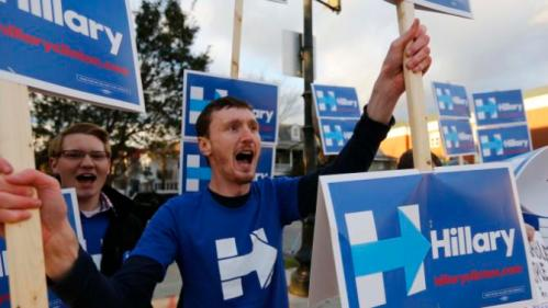 Josh McCafferty of New Jersey, cheers for Democratic presidential candidate, Hillary Clinton before the start of the NBC, YouTube Democratic presidential debate at the Gaillard Center, Sunday, Jan. 17, 2016 in Charleston, SC. (AP Photo/Mic Smith)
