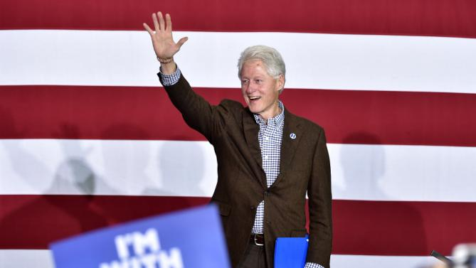 Former President Bill Clinton waves to the crowd before speaking at a campaign event for his wife, Democratic presidential candidate Hillary Clinton, on Thursday, Jan. 21, 2016, in Las Vegas. (AP Photo/David Becker)