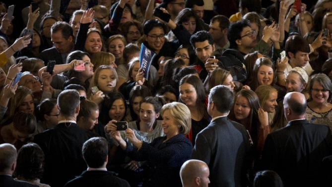 Democratic presidential candidate Hillary Clinton, center, takes a selfie with students during a rally on the campus of University of Iowa Thursday, Jan. 21, 2016, in Iowa City, Iowa. (AP Photo/Jae C. Hong)