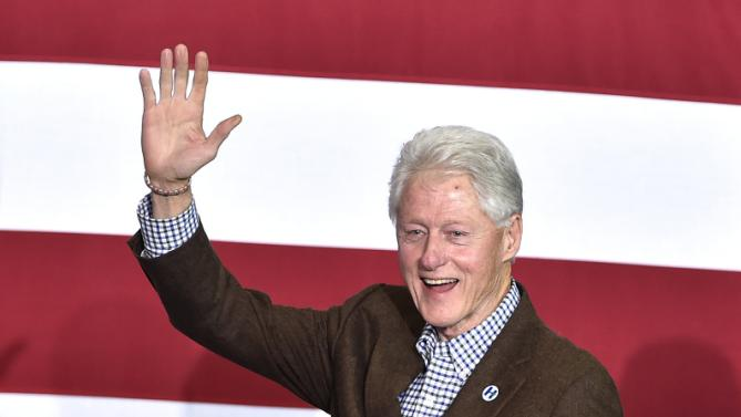 Former President Bill Clinton, with his notes in hand, waves to the crowd as he arrives to speaks at a campaign event for his wife, Democratic presidential candidate Hillary Clinton, on Thursday, Jan. 21, 2016, in Las Vegas. (AP Photo/David Becker)