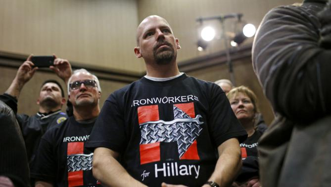 Supporters listen to Democratic presidential candidate Hillary Clinton speak at a campaign event in Burlington, Iowa, Wednesday, Jan. 20, 2016. (AP Photo/Patrick Semansky)