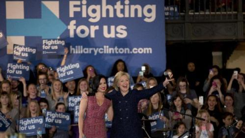 Democratic presidential candidate Hillary Clinton, right, and musician Demi Lovato acknowledge the cheering crowd at a rally on the campus of University of Iowa Thursday, Jan. 21, 2016, in Iowa City, Iowa. (AP Photo/Jae C. Hong)