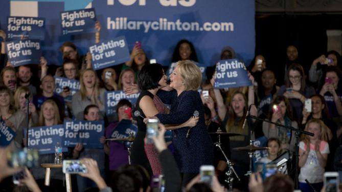 Democratic presidential candidate Hillary Clinton, right, hugs musician Demi Lovato at a rally on the campus of University of Iowa Thursday, Jan. 21, 2016, in Iowa City, Iowa. (AP Photo/Jae C. Hong)