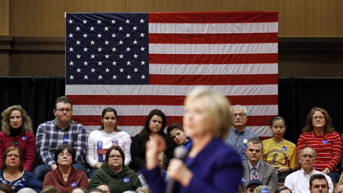People listen as Democratic presidential candidate Hillary Clinton during a campaign event in Burlington, Iowa, Wednesday, Jan. 20, 2016. (AP Photo/Patrick Semansky)