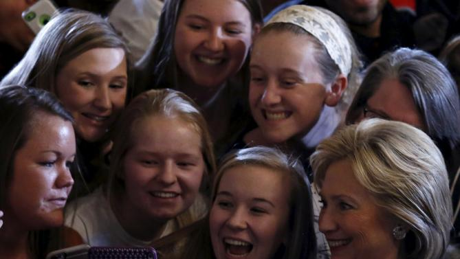 U.S. Democratic presidential candidate Hillary Clinton poses for a photo with attendees at a campaign event in Iowa City, Iowa, United States, January 21, 2016. REUTERS/Jim Young