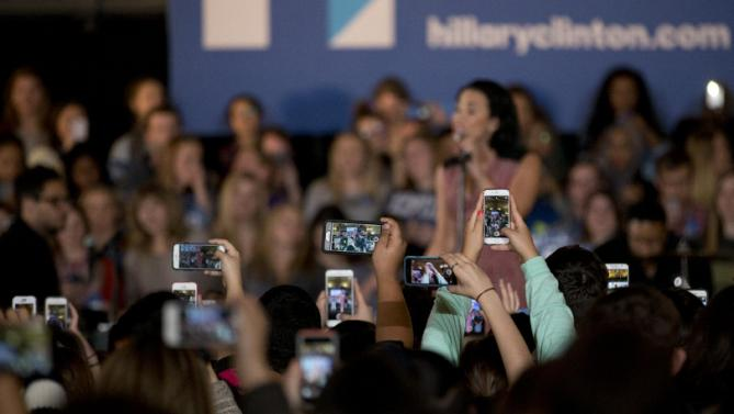 People take pictures of Demi Lovato at a rally for Democratic presidential candidate Hillary Clinton, on the campus of University of Iowa Thursday, Jan. 21, 2016, in Iowa City, Iowa. (AP Photo/Jae C. Hong)