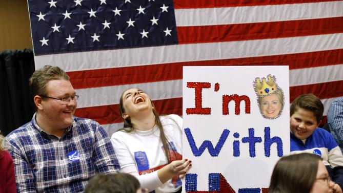 Kayla Kaminski, second from left, laughs as she waits for a campaign event featuring Democratic presidential candidate Hillary Clinton to begin in Burlington, Iowa, Wednesday, Jan. 20, 2016. (AP Photo/Patrick Semansky)