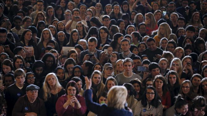 Attendees listen to U.S. Democratic presidential candidate Hillary Clinton at a campaign event in Iowa City, Iowa, United States, January 21, 2016. REUTERS/Jim Young