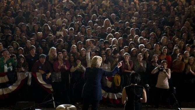 Democratic presidential candidate Hillary Clinton, joined by musician Demi Lovato, right, speaks during a rally on the campus of University of Iowa Thursday, Jan. 21, 2016, in Iowa City, Iowa. (AP Photo/Jae C. Hong)