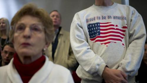 Supporters listen to Democratic presidential candidate Hillary Clinton during a rally Thursday, Jan. 21, 2016, in Vinton, Iowa. (AP Photo/Jae C. Hong)