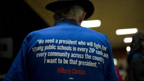 A man wears a t-shirt supporting Democratic presidential candidate Hillary Clinton during a rally Thursday, Jan. 21, 2016, in Vinton, Iowa. (AP Photo/Jae C. Hong)