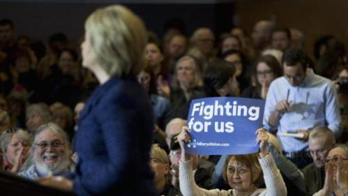 A supporter holds up a sign while listening to Democratic presidential candidate Hillary Clinton speak during a rally on the campus of Simpson College, Thursday, Jan. 21, 2016, in Indianola, Iowa. (AP Photo/Jae C. Hong)