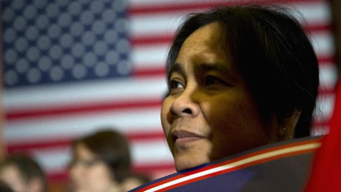 Benilda Roberts listens as Democratic presidential candidate Hillary Clinton speaks during a rally on the campus of Simpson College, Thursday, Jan. 21, 2016, in Indianola, Iowa. (AP Photo/Jae C. Hong)