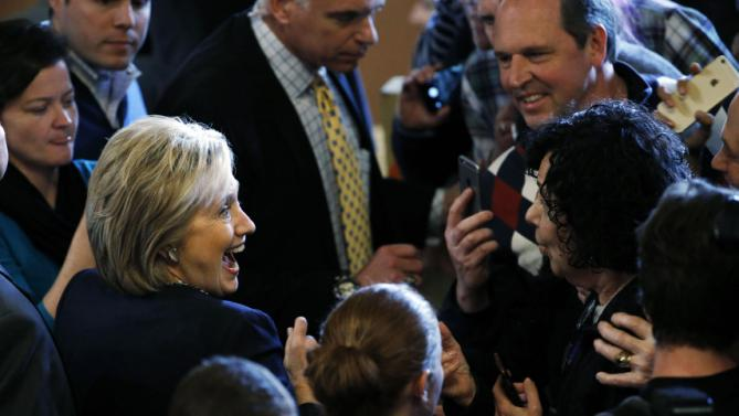Democratic presidential candidate Hillary Clinton meets with attendee during a campaign stop Friday, Jan. 22, 2016, in Rochester, N.H. (AP Photo/Matt Rourke)