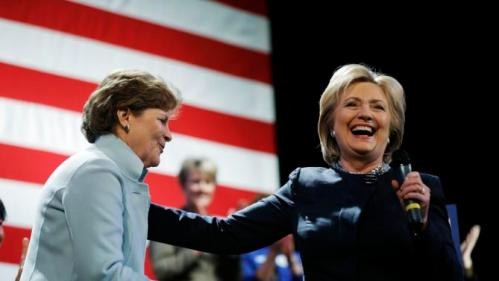 Democratic presidential candidate Hillary Clinton, right, takes the microphone after being introduced by Sen. Jeanne Shaheen, D-N.H., during a campaign stop Friday, Jan. 22, 2016, in Rochester, N.H. (AP Photo/Matt Rourke)