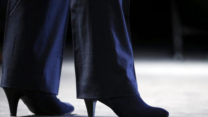 Shown are Democratic presidential candidate Hillary Clinton's shoes as she speaks at a campaign stop Friday, Jan. 22, 2016, in Rochester, N.H. (AP Photo/Matt Rourke)