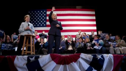 Democratic presidential candidate Hillary Clinton, center, accompanied by Sen. Jeanne Shaheen, D-N.H., gestures during a campaign stop Friday, Jan. 22, 2016, in Rochester, N.H. (AP Photo/Matt Rourke)