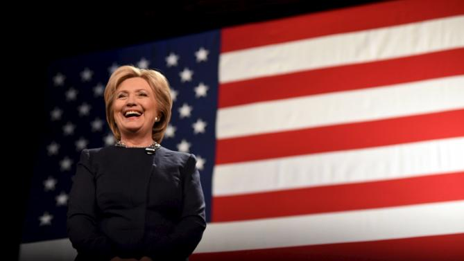 U.S. Democratic presidential candidate Hillary Clinton reacts to a question at the Rochester Opera House campaign town hall meeting in Rochester, New Hampshire January 22, 2016.   REUTERS/Faith Ninivaggi