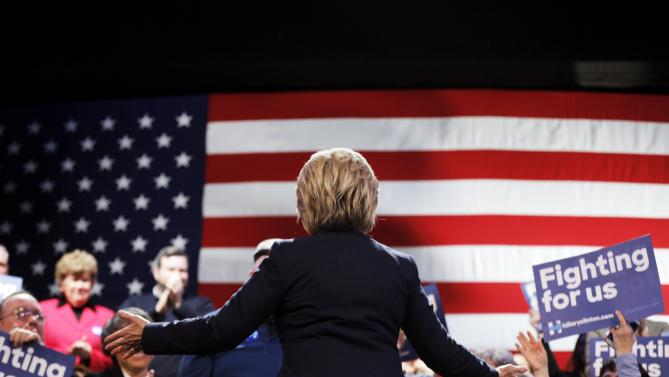 Democratic presidential candidate Hillary Clinton takes the stage during a campaign stop Friday, Jan. 22, 2016, in Rochester, N.H. (AP Photo/Matt Rourke)