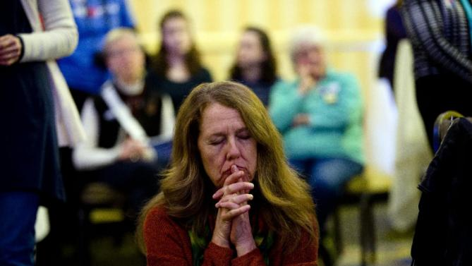 Bonnie Argeropoulos listens to Democratic presidential candidate Hillary Clinton speak Friday, Jan. 22, 2016, at a NARAL Pro-Choice dinner in Concord, N.H. (AP Photo/Matt Rourke)