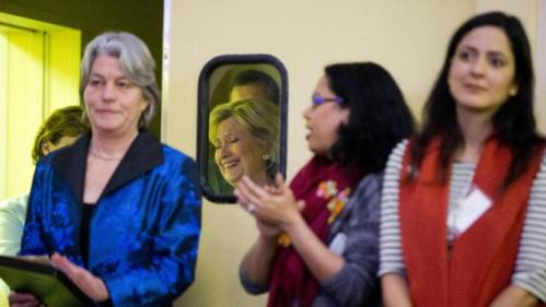 Democratic presidential candidate Hillary Clinton, second left, listens to her introduction Friday, Jan. 22, 2016, at a NARAL Pro-Choice dinner in Concord, N.H. (AP Photo/Matt Rourke)