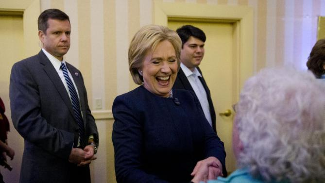 Democratic presidential candidate Hillary Clinton meets an attendee Friday, Jan. 22, 2016, at a NARAL Pro-Choice dinner in Concord, N.H. (AP Photo/Matt Rourke)