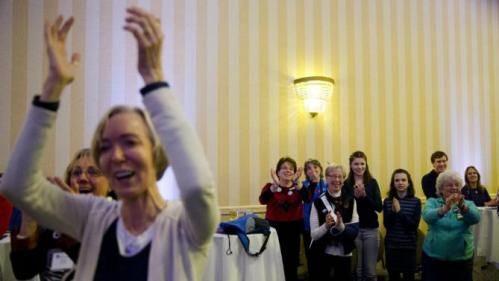 Attendees cheer Democratic presidential candidate Hillary Clinton as she speaks Friday, Jan. 22, 2016, at a NARAL Pro-Choice dinner in Concord, N.H. (AP Photo/Matt Rourke)