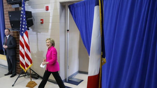 Democratic presidential candidate Hillary Clinton walks into a town hall at Eagle Heights Elementary School in Clinton, Iowa, Saturday, Jan. 23, 2016. (AP Photo/Patrick Semansky)