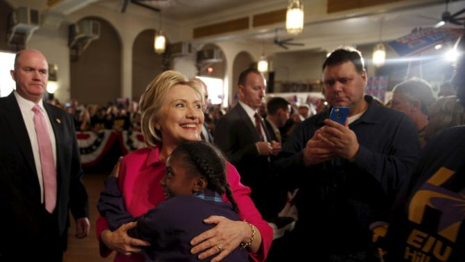 Democratic U.S. presidential candidate Hillary Clinton gets a hug from Amari Ogleton, 8, of Milwaukee, Wis., after speaking at the Hard Hats for Hillary event at the Danceland Ballroom in Davenport, Iowa, January 23, 2016. REUTERS/Scott Morgan