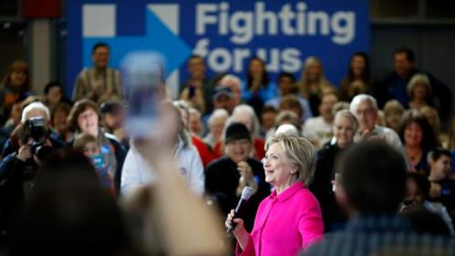 Supporters greet Democratic presidential candidate Hillary Clinton as she arrives at a town hall at Eagle Heights Elementary School in Clinton, Iowa, Saturday, Jan. 23, 2016. (AP Photo/Patrick Semansky)