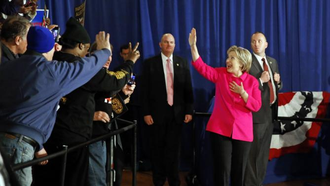Democratic presidential candidate Hillary Clinton greets attendees as she arrives at a campaign event at Danceland Ballroom in Davenport, Iowa, Saturday, Jan. 23, 2016. (AP Photo/Patrick Semansky)