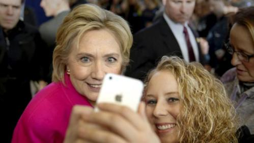 Democratic U.S. presidential candidate Hillary Clinton takes a photo with Hope-Marie Murphy, 27, of Clinton, Iowa, after a Get Out the Caucus event at the Eagle Heights Elementary School in Clinton, Iowa, January 23, 2016. REUTERS/Scott Morgan
