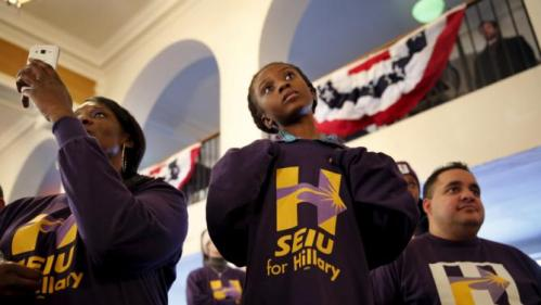 Amari Ogleton, 8, of Milwaukee, Wis., listens as Democratic U.S. presidential candidate Hillary Clinton speaks during the Hard Hats for Hillary event at the Danceland Ballroom in Davenport, Iowa, January 23, 2016. REUTERS/Scott Morgan