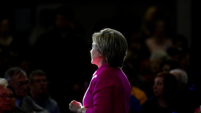 Sunlight shines on Democratic presidential candidate Hillary Clinton as she listens to an attendee's question during a town hall at Eagle Heights Elementary School in Clinton, Iowa, Saturday, Jan. 23, 2016. (AP Photo/Patrick Semansky)