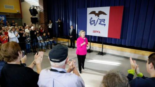 People applaud Democratic presidential candidate Hillary Clinton during a town hall at Eagle Heights Elementary School in Clinton, Iowa, Saturday, Jan. 23, 2016. (AP Photo/Patrick Semansky)