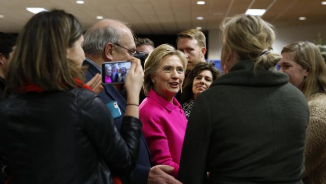 Democratic presidential candidate Hillary Clinton visits with attendees before speaking at the Scott County Democrats Red, White and Blue Banquet in Davenport, Iowa, Saturday, Jan. 23, 2016. (AP Photo/Patrick Semansky)