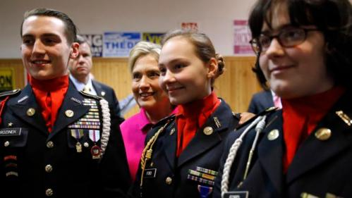 Democratic presidential candidate Hillary Clinton poses for a photograph with members of a color guard after speaking at the Scott County Democrats Red, White and Blue Banquet in Davenport, Iowa, Saturday, Jan. 23, 2016. (AP Photo/Patrick Semansky)