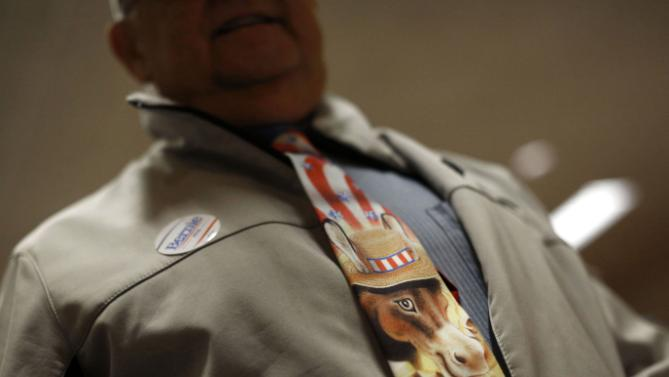Larry D'Autremont wears a Democratic Party-themed tie before listening to Democratic presidential candidate Hillary Clinton speak at the Scott County Democrats Red, White and Blue Banquet in Davenport, Iowa, Saturday, Jan. 23, 2016. (AP Photo/Patrick Semansky)