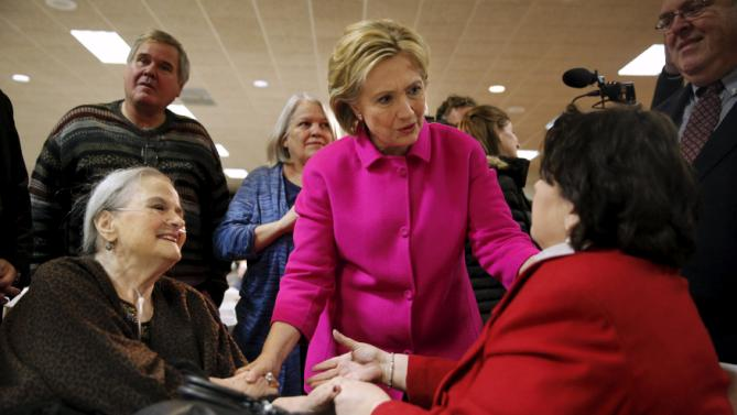 Democratic U.S. presidential candidate Hillary Clinton meets Cathleen Hart (right) and her mother Helen Hart, both of Davenport, while mingling with the crowd at the Scott County Democratic Party's Red, White and Blue Dinner at the Mississippi Valley Fairgrounds in Davenport, Iowa, January 23, 2016. REUTERS/Scott Morgan