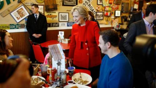 Democratic presidential candidate Hillary Clinton greets diners at Riley's Cafe in Cedar Rapids, Iowa, Sunday, Jan. 24, 2016. (AP Photo/Patrick Semansky)