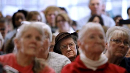 Supporters listen as U.S. Democratic presidential candidate Hillary Clinton speaks during a Get Out the Caucus event with Senator Cory Booker at Vernon Middle School in Marion, Iowa, January 24, 2016. REUTERS/Scott Morgan