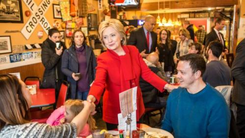 CEDAR RAPIDS, IOWA - JANUARY 24: Democratic presidential candidate Hillary Clinton (C) greets diners at Riley's Cafe on January 24, 2016 in Cedar Rapids, Iowa. The Democratic and Republican Iowa Caucuses, the first step in nominating a presidential candidate from each party, will take place on February 1. (Photo by Brendan Hoffman/Getty Images)