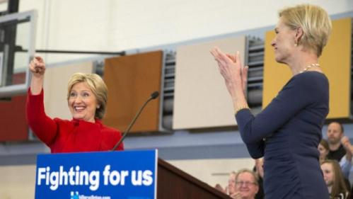 Planned Parenthood president Cecile Richards, right, applauds Democratic presidential candidate Hillary Clinton during a campaign rally at Burford Garner Elementary School, on Sunday, Jan. 24, 2016, in North Liberty, Iowa. (AP Photo/Evan Vucci)