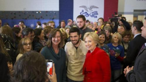 Democratic presidential candidate Hillary Clinton takes photos with supporters during a campaign rally at Burford Garner Elementary School, on Sunday, Jan. 24, 2016, in North Liberty, Iowa. (AP Photo/Evan Vucci)