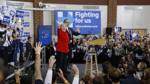 Democratic presidential candidate Hillary Clinton waves to supporters alongside Chad Griffin, president of the Human Rights Campaign, at Valley Southwoods Freshman High School in West Des Moines, Iowa, Sunday, Jan. 24, 2016. (AP Photo/Patrick Semansky)